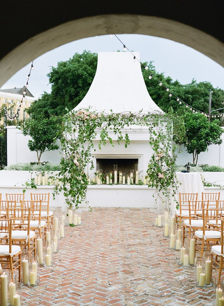 Lucite wedding pergola covered in florals.  Stunning outdoor fireplace with clear votives.  Southern New Orleans Wedding Photographers - Destination Worldwide Weddings - Film & Digital Photography - Arte De Vie - www.artedevie.com @kimstarrwise @sapphi