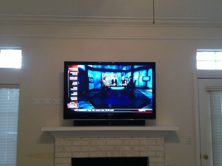 TV over the fireplace with Bluetooth soundbar to improve