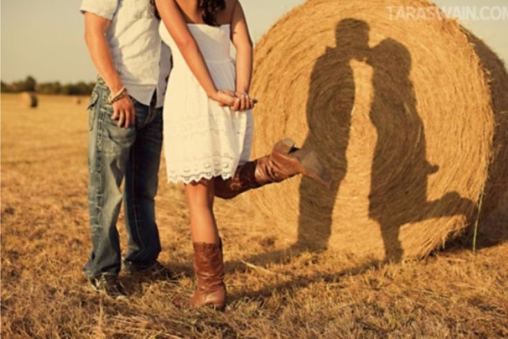 Country Engagement Photos--would b cute if they were laying down in front of the hay bale, at night with truck lights on them