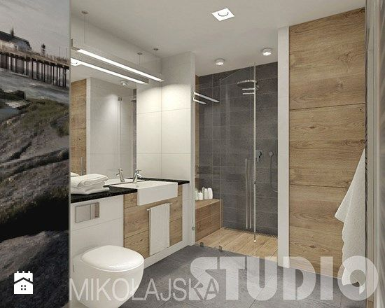 TAK! biało drewniana aranzacja, wydzielona kolorystycznie strefa prysznica, obok prysznica wysoka zabudowa maskująca pralkę i inne szafki