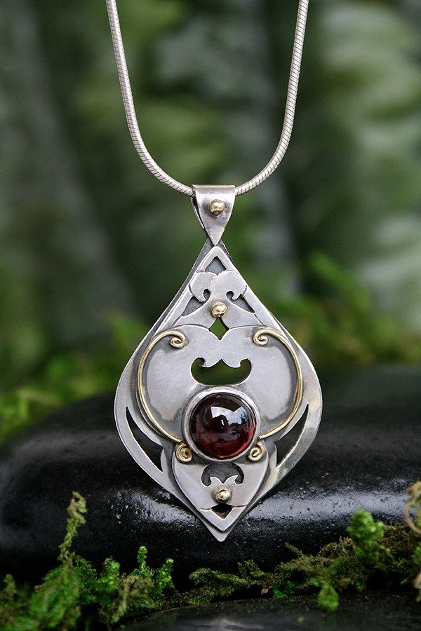 One of a kind Garnet Pendant with 22k Gold on Sterling Silver. Made with love! www.melissacaron.com