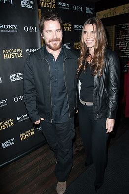 """Christian Bale with his wife at the """"American Hustle"""" (2013) premiere at the Lighthouse International's Academy Theater in New York on December 6, 2013."""