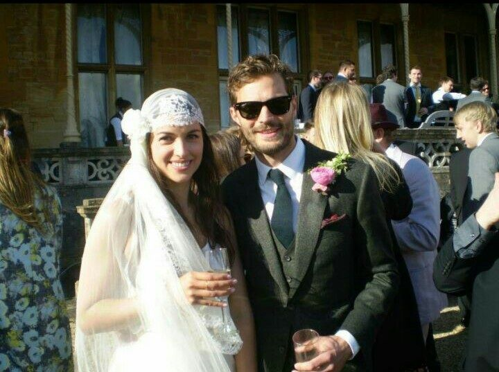 The lovely Jamie Dornan & Amelia Warner enjoying the sunshine on their Big Day at Orchardleigh House! We love Amelia's veil - truly stunning #jamiedornan #ameliawarner #fiftyshadesofgrey