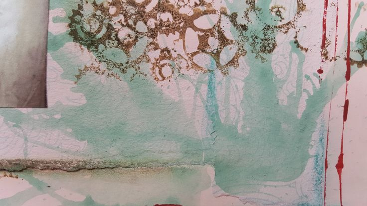 Adding dimension to pages with watered down acrylic paint and blowing it with straws. Great fun!