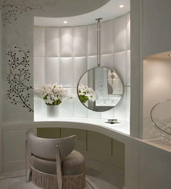 Round wall decor with mirror, flower, and good lighting
