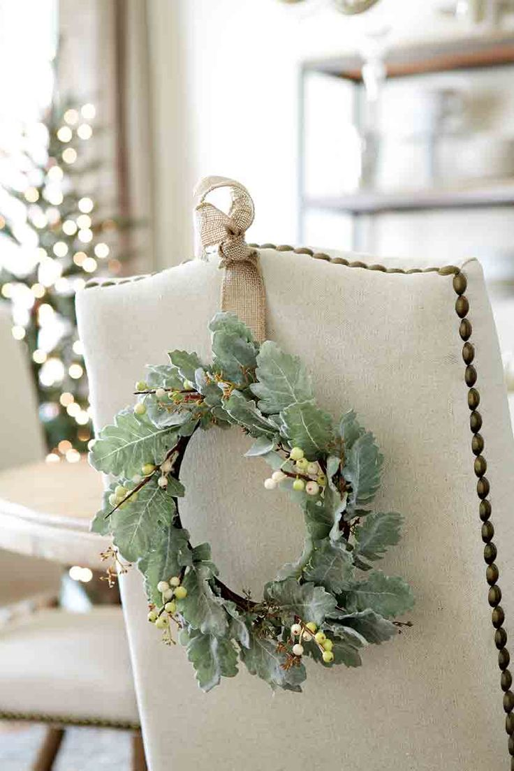 hang wreaths on the back of dining room chairs could put wreaths or ornaments on the back of the chairs - Pinterest Christmas Decor