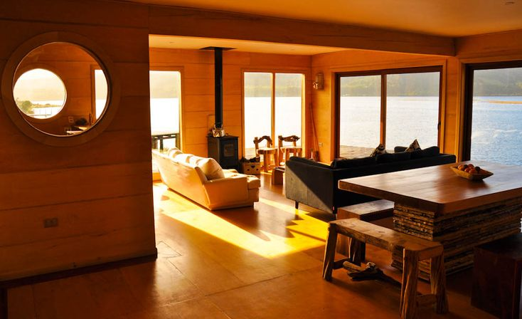 Palafito Hostel living room overlooking Lake Cucao! #chile #patagonia More photos and video of Palafito Hostel on http://www.bkpk.me