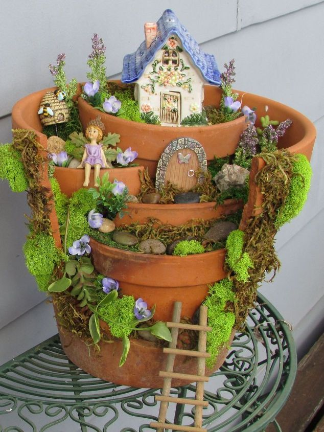 Fairy Garden Container Ideas amazing miniature garden design with patio furniture and lights Find This Pin And More On Garten Pflanzen My Latest Fairy Garden