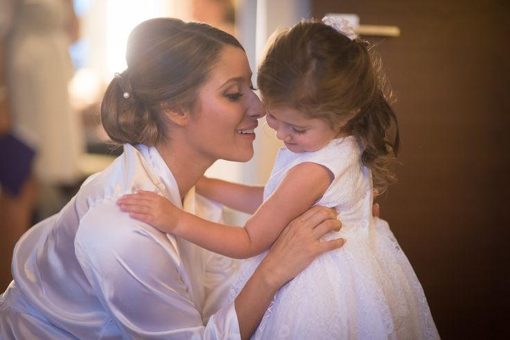 Jen sharing a moment with her flower girl just before the wedding! Jen and Noah's wedding at the National Museum of Women in the Arts in Washington, DC.