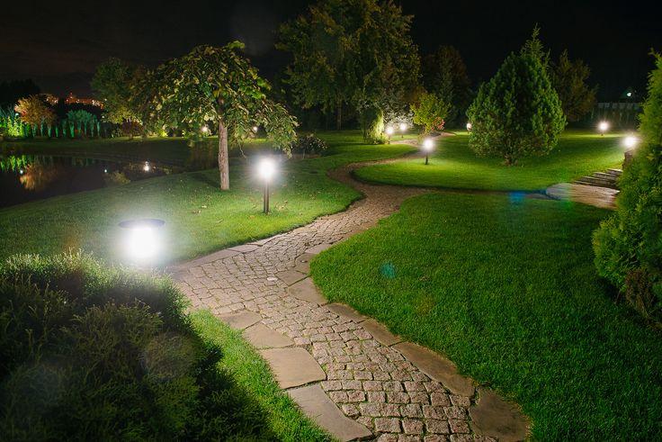 Path lighting in a very beautiful garden. Lighting design by Belisama Lighting and the lighting designer Kamil Akhmedov.