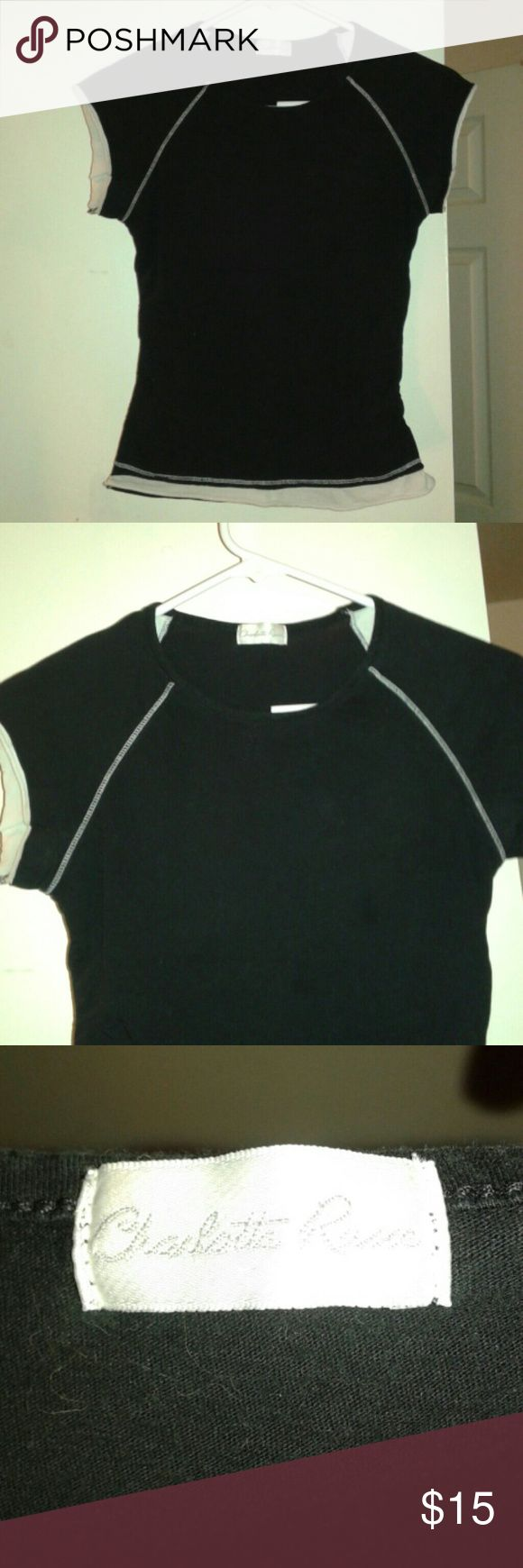 Awesome black and white tee Awesome black and white tee shirt made by Charlotte Russe.  Size small. Super cute to work out in or with jeans! Charlotte Russe Tops Tees - Short Sleeve