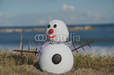 Concept of snow man on stones