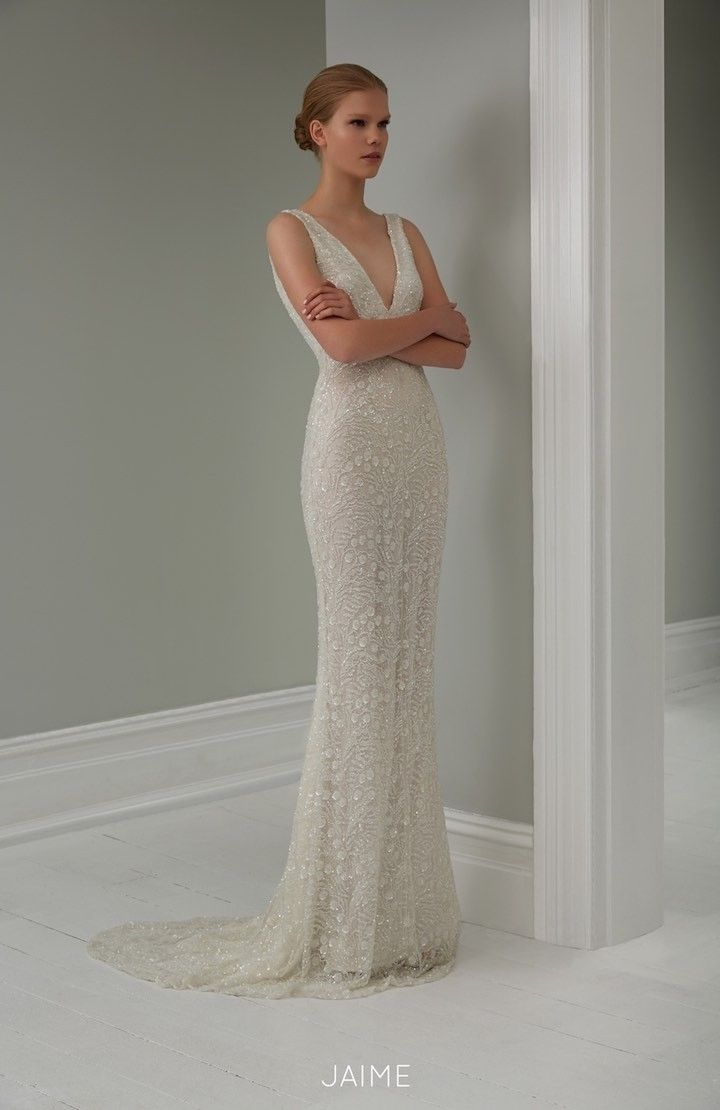 V neckline wedding gown from 2015 Steven Khalil Wedding Dress Collection : http://www.itakeyou.co.uk/wedding/steven-khalil-bridal-2015-collection/ #weddingdress: