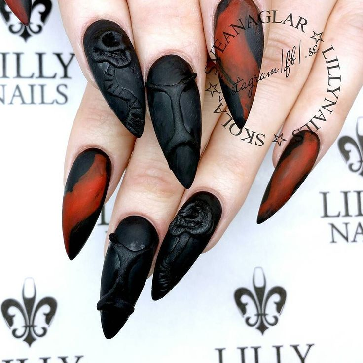 Sculpted acrylic skulls. Also Black and Fire Red Gel Polish. Inspo from the…