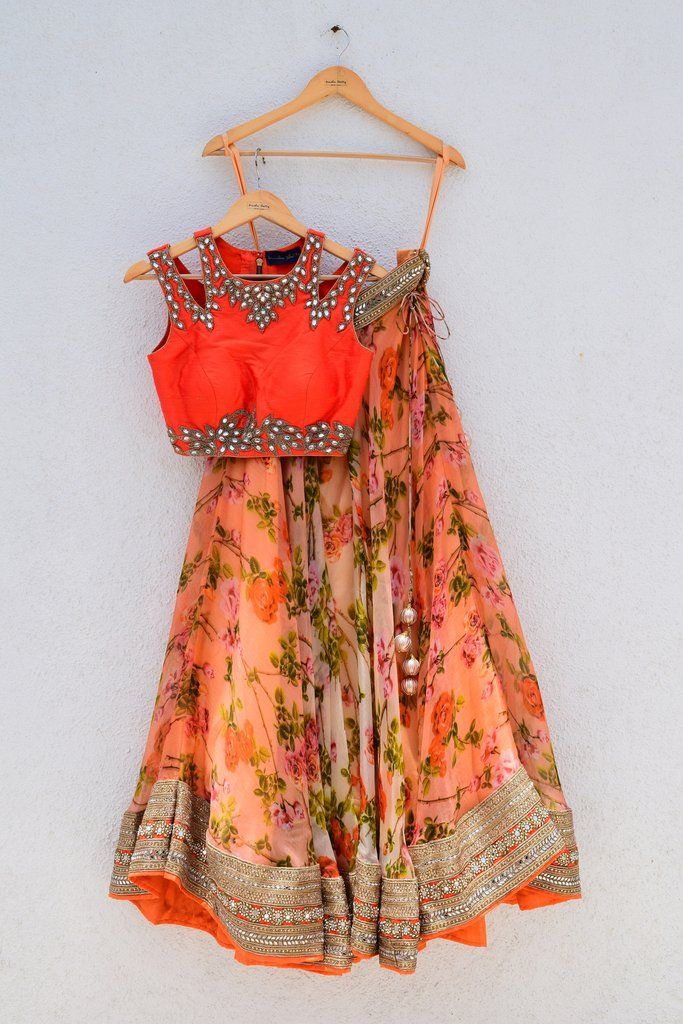 Floral printed lehenga with orange cutwork blouse