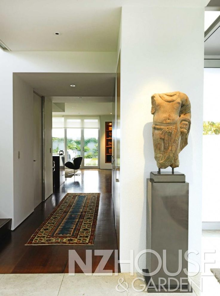 Looking towards the kitchen from the dining room; the guardian sculpture is from India and dates to around the second century.