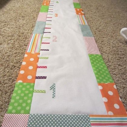 Fabric Growth Chart. I could do this with material from my grandfather's shirts.