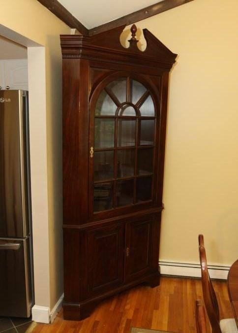 Large Corner Cabinet With Single Glass Door Over Two Doors