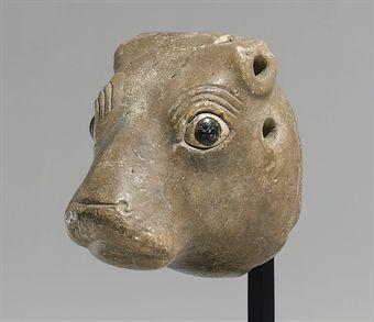 A Sumerian limestone bullhead protome, circa mid 3rd millennium B.C.E.