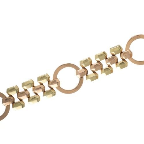 A wide retro two tone gold statement bracelet. View our collection of antique, Art Deco, and modern jewellery at www.rutherford.com.au
