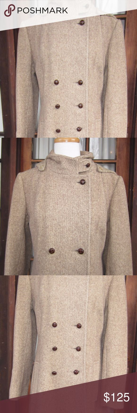 Vintage Double Breasted Herringbone Tweed Coat Ladies Double breasted Brown Herringbone Tweed Coat from Sears. Removable hood.  Leather buttons.  Belt across the back.  Slight moth damage on the one sleeve and across the bottom of the coat therefore, (please see the last picture) It blends in with the tweed pattern of the coat. No size is on the tags.  Measurements Vintage Jackets & Coats Trench Coats