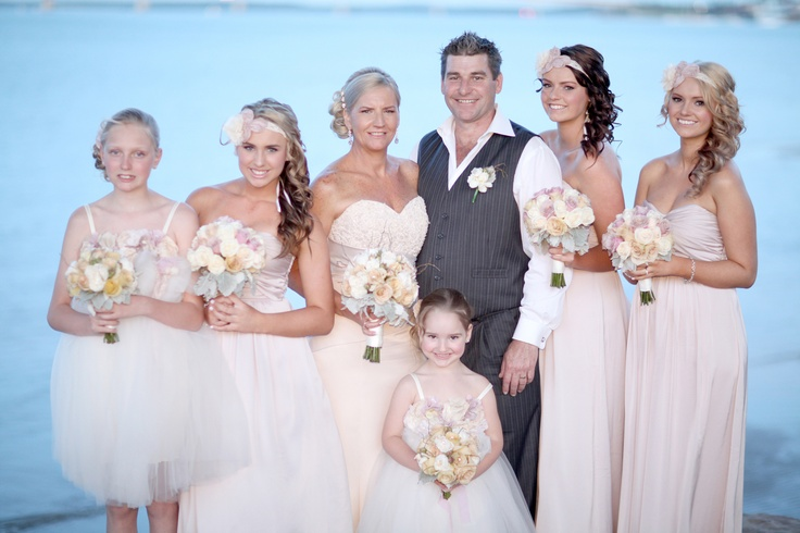 Beautiful photo of Michelle & Ray on their wedding day with their daughters