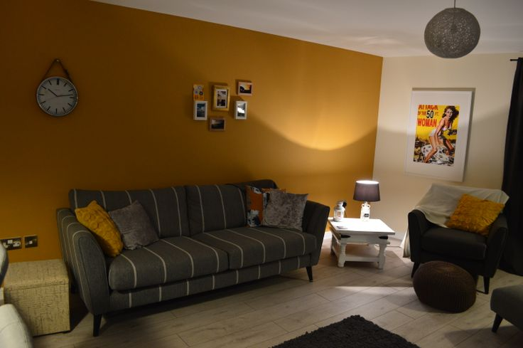 living room - farrow and ball india yellow paint, belt clock, attack of the 50ft woman poster