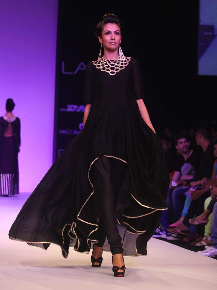 #Effortless. #Perfection. I'm about to meet you, #impress you, and #dazzle you into #submission without ever saying a word. #Black and #gold #anarkali from Lakme Fashion Week Winter/Festive 2013: #PayalSinghal