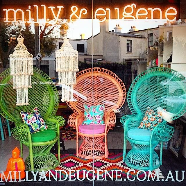 Our front window featuring our gorgeous Peahen Chairs.