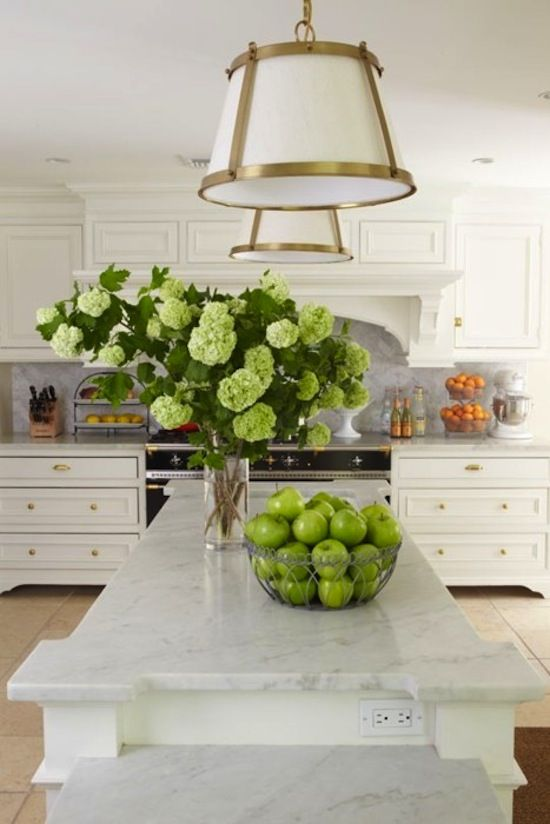 kitchen: white cabinets with a carrara countertop