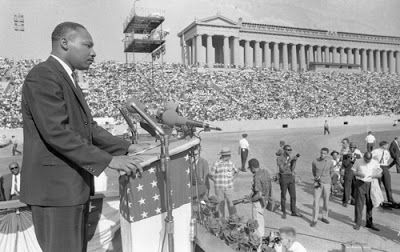 Heretic, Rebel, a Thing to Flout: Dr. King Kicked Off his Chicago Campaign with Huge Soldier Field Rally.  More than 60,000 bodies crammed into Chicago's Soldier Field, then the seating capacity of the stadium on the Lake on Sunday, July 10, 1966.  The Sun-Times reported the next day that thousands more were turned away.  Although mega-watt stars were on hand to perform including Mahalia Jackson, Stevie Wonder, and Peter Paul and Mary not a single ticket was sold to see them.  The real star…