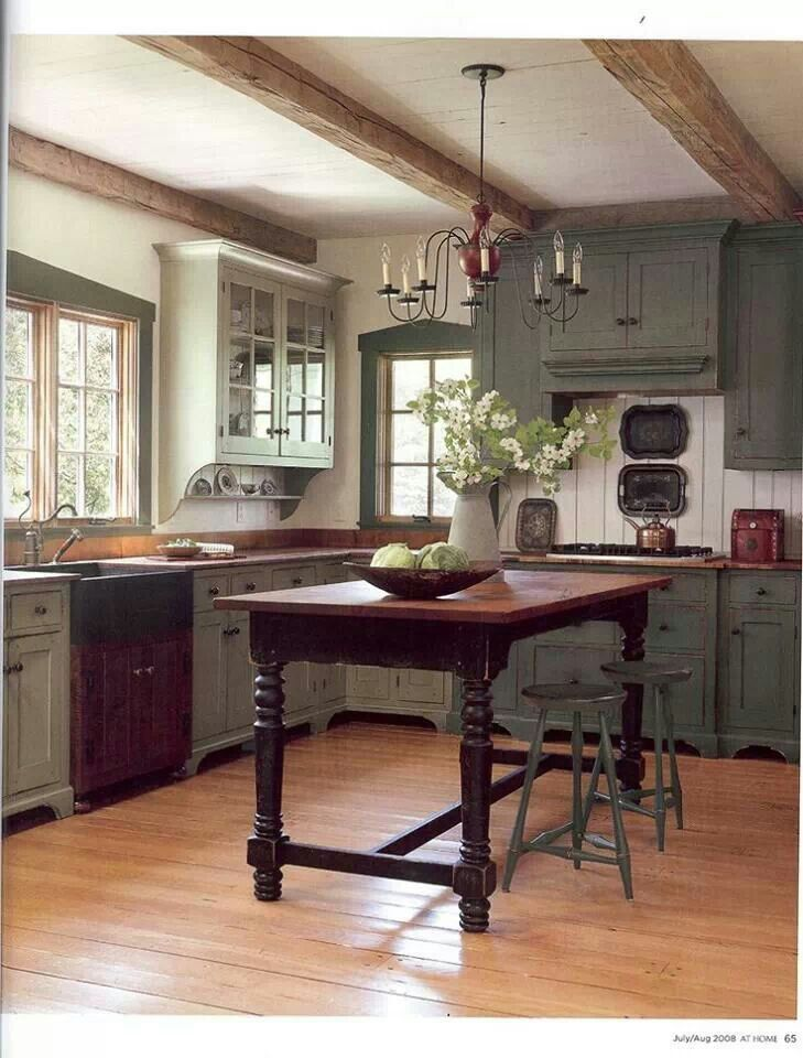 Lovely sage green cabinets in this farmhouse kitchen.