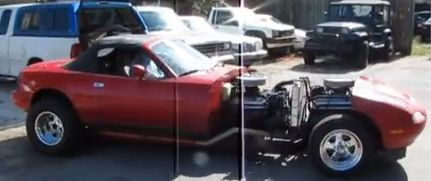 Double V8 Miata engine swap. See the link for more details, including videos of it running.  Finally, a Miata with enough power? :-)