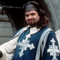 Porthos (Oliver Platt) Because a movie is automatically 60% better when you add Oliver Platt.