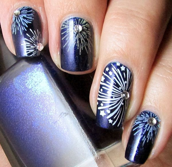 Fireworks are this nail design's inspiration. Create the effect with a small nail art brush or tooth pick and some snazzy gems. #fireworks #nailart #4thofjulynails