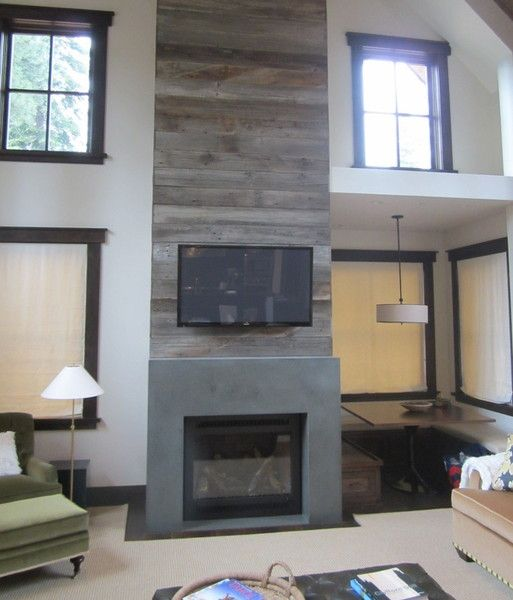 concrete fireplace surround by buckets of stone color is crestwood green reclaimed wood and concrete
