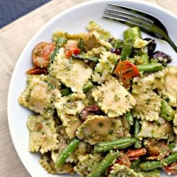 Pesto pasta salad with roasted asparagus, string beans, cherry tomatoes and olives.
