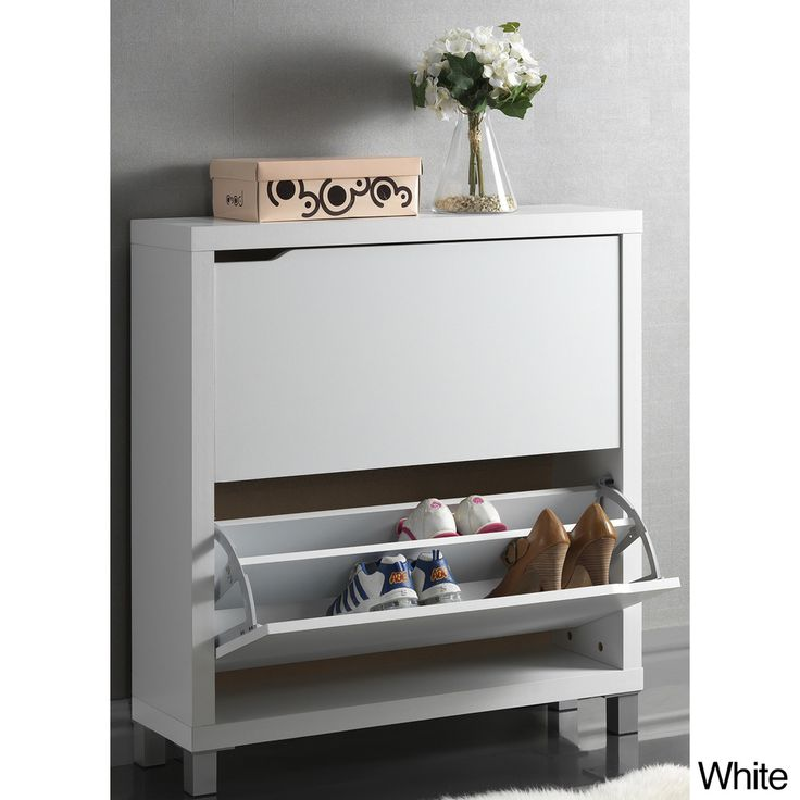 Place this modern double shoe cabinet anywhere around the house. With sleek fold ins, this cabinet will disguise holding your shoes, as well as create extra storage room in your closet.