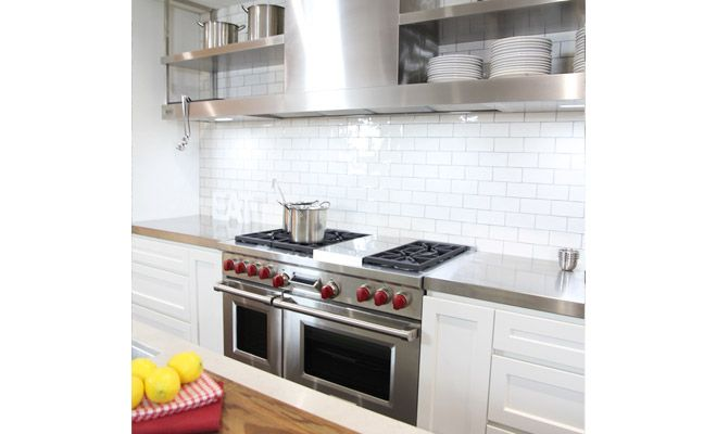 Open shelving, stainless steel appliances and white tiles create a modern, industrial look in this Winning Kitchen in Castle Hill. Designed by Kastell Kitchens the appliances include: Abey Tap Fisher & Paykel Dishwasher Oliveri Sink Sub-Zero Fridge Wolf Oven Qasair Rangehood