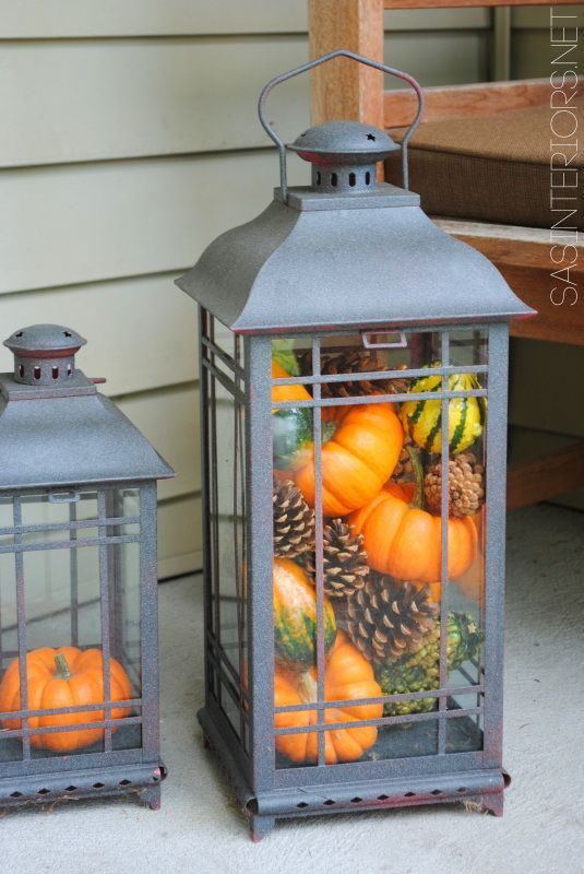 Fill lanterns with pumpkins and gourds for easy fall decor. Use the lanterns inside for a festive centerpiece or outside for a friendly fall welcome on your front porch.