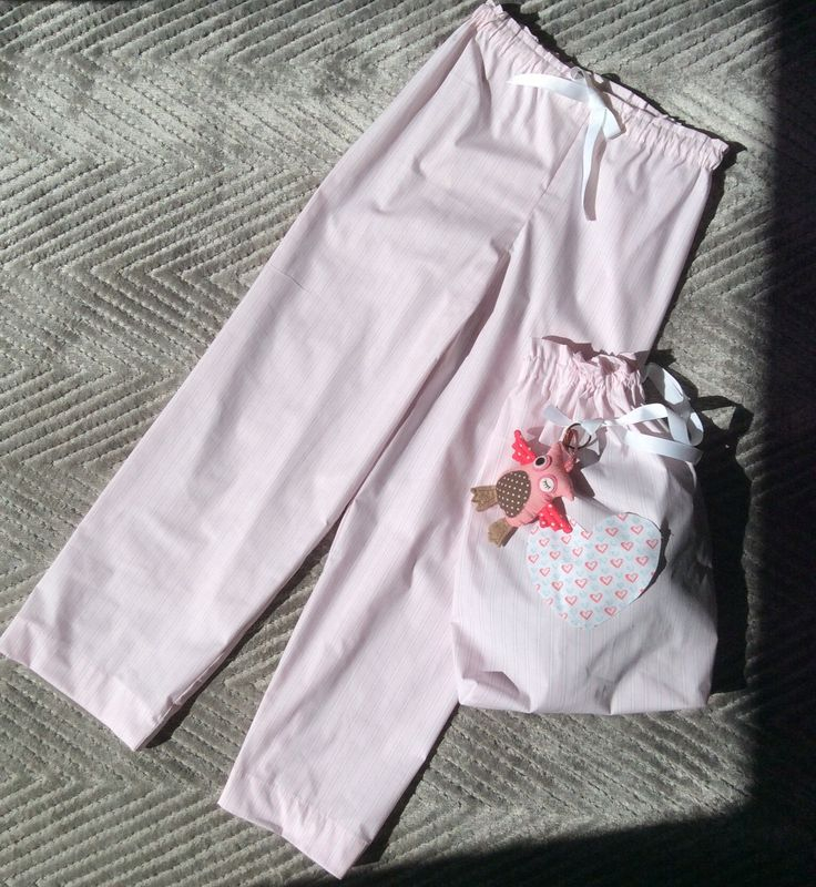 Pyjama pants and heart shape for appliqué on drawstring bag with owl soft toy attached. Paper bag waist with bow tied at front for adjustable fit.