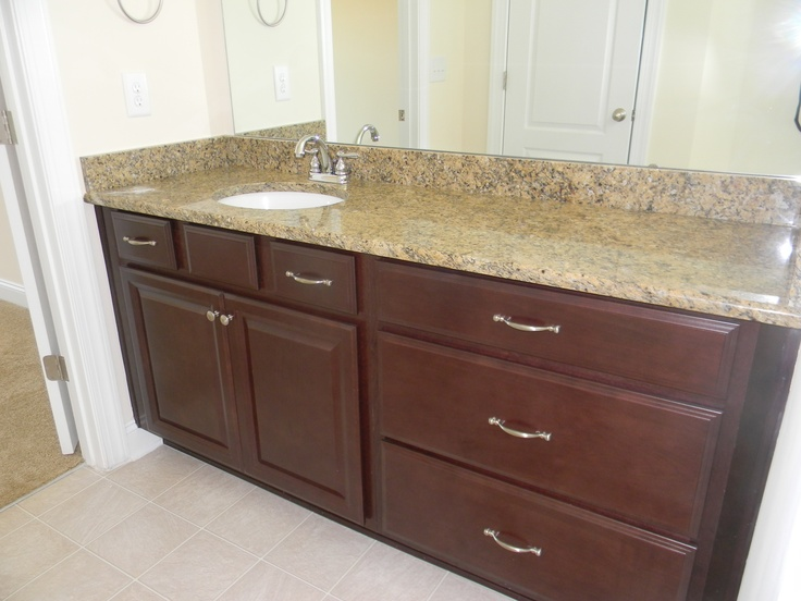 Simple  Vanities Include Storage Cabinets And Knee Space In The Master Bath