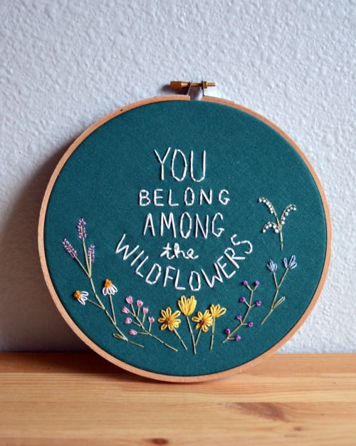 'you belong among the wildflowers' hoop art by breezebotpunch a sweet and simple sentiment in a surprisingly lovely needlepoint style — i can't get over the different flowers represented by different...