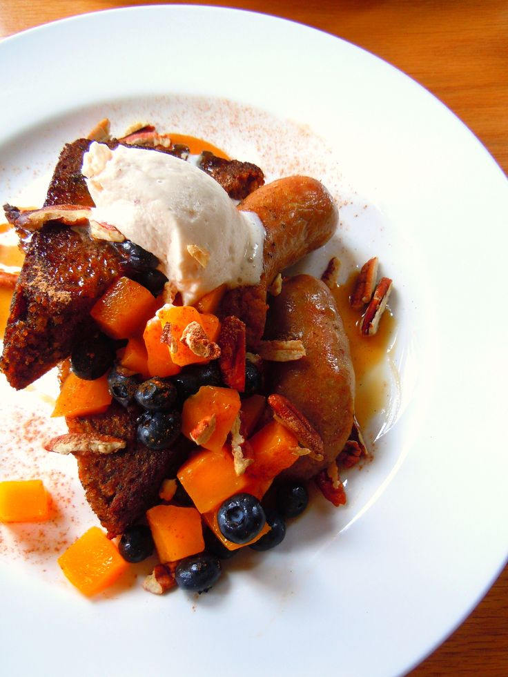 Weekend brunch at Toronto's Gladstone Hotel!  Banana bread French toast with mangoes, blueberries, pecans and pecan cream with sausages!