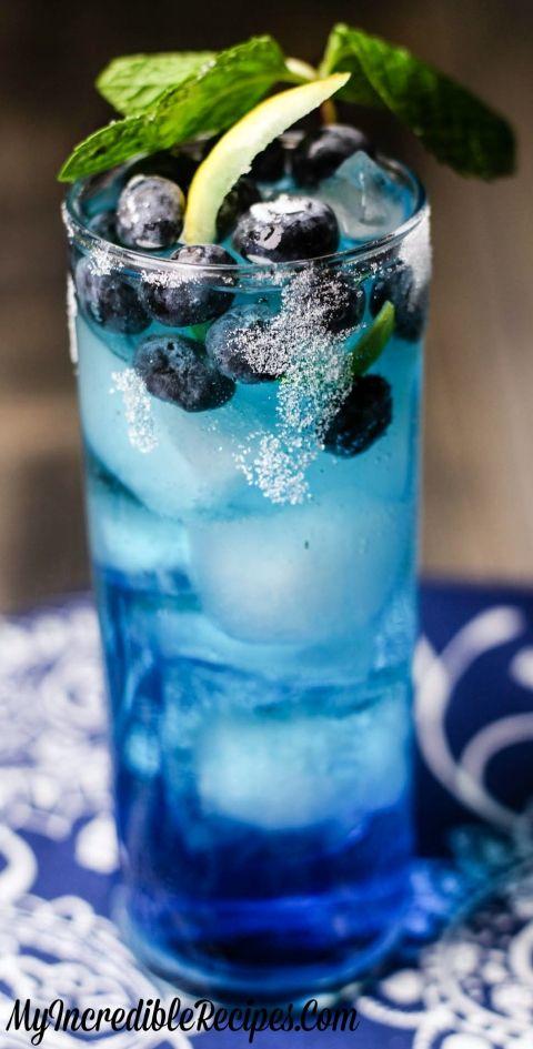 Blue Cream Soda + Lemonade Vodka + Blueberries + Lemon Juice & Twist + Sugar Rim = Banging Blueberry Lemonade