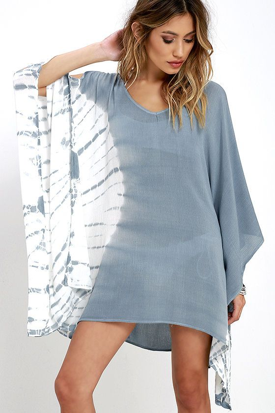 Your vacation can start a little early when the Colored Mist Blue Grey Tie-Dye Kaftan Top is in the mix! Woven tie-dye fabric shapes a wide V neckline and sloping back with horizontal strap. Loose bodice is framed by fluttering kimono sleeves.