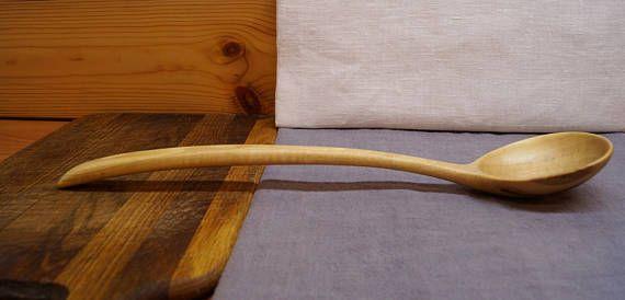 Wooden serving spoon ladle from walnut,wooden spoon,wood spoons,kitchen wooden utensil,carved wooden spoon,cooking ladle,kitchen,chefs gift  Оригинальная поварёшка ручной работы вырезанная из древесины грецкого ореха. . Длина поварёшки 13,3 ( 34 см). Размеры чаши 3,1L * 2,7W ( 8 * 7 см). Глубина 0,6 ( 1,5 см).  Ложка изготовлена с помощью топора и ножа,тщательно отполирована и покрыта смесью льняного масла, пчелиного воска и карнаубского воска.   Деревянные ложки будут служить вам долго,если…