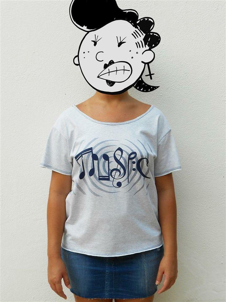 http://www.agentestampa.iluria.com  -Estampa 'MUSIC' -Camiseta feminina -Tamanho ÚNICO -Modelagem 't-shirt básica' -Decote careca -Composição do tecido: 50% poliéster 50% algodão -Aparência do tecido: mesclado