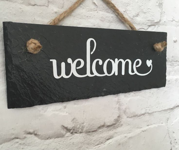 A personal favourite from my Etsy shop https://www.etsy.com/uk/listing/281270788/welcome-slate-sign-house-sign-welcome