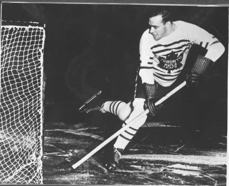 Charlie Conacher poses for an action portrait with the Toronto Maple Leafs no later than the fall of 1934 at Maple Leaf Gardens. (HHOF/Images on ice)